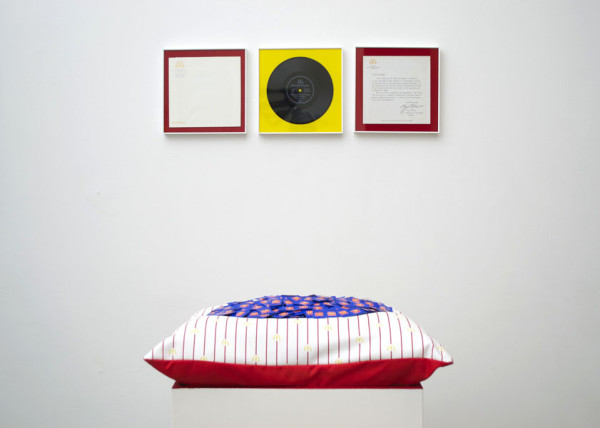 Cyril Duval, Voir Dire, 2014 Framed McDonalds memorabilia, digitized audio file, cushion with custom pillow case, McDonalds sweeteners, wood pedestal, drawings, 20 x 22 x 40in (52 x 56 x 103cm), Frames 10 x 10in (25 x 25cm)