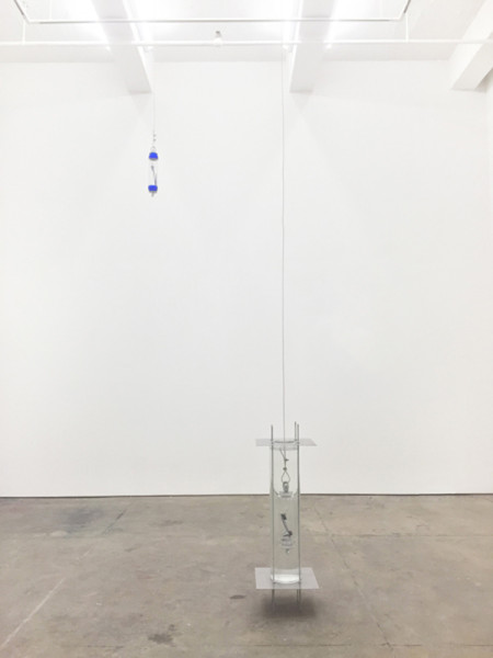 Carson Fisk-Vittori, Taking a picture underneath a puddle (thermometer), 2015Glass, municipal water, damar tree resin, white beeswax, blue pigment, magnetic hematite, steel parts, polycarbonate, aluminum, Dimensions Variable