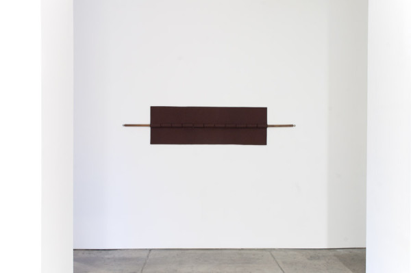 Installation view,  Johanna Unzueta,  Hinge,  2012 Felt, thread and wood ,  4 x 21 x 2.5 inches
