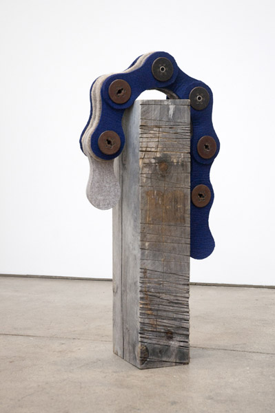 Johanna Unzueta, Chain, 2012Felt, wooden spools and recycled beam, Dimensions variable