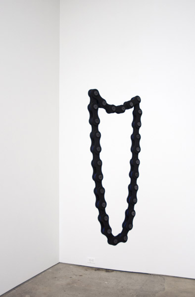 Johanna Unzueta, Black and Electric Blue Chain, 2012Felt and wooden spools, Dimensions variable