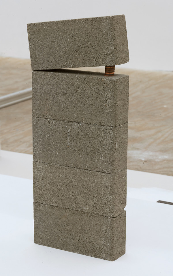 Adrián S. Bará, Untitled (Lo real es aquello a lo que no hay que ceder) , 2017, Copper pennies, concrete, 19 x 8 inches (48.26 x 20.32 cm).