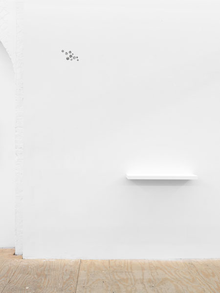 """Felix Gonzalez-Torres, """"Double Fear,"""" 1987, rub-on transfer, Private Collection, New York Kris Martin, """"Self-portrait (pins),"""" 2008 Two found pins, painted wood shelf 1 5/8 × 31 1/2 × 7 3/4 inches (4.13 × 80.01 × 19.69 cm)"""