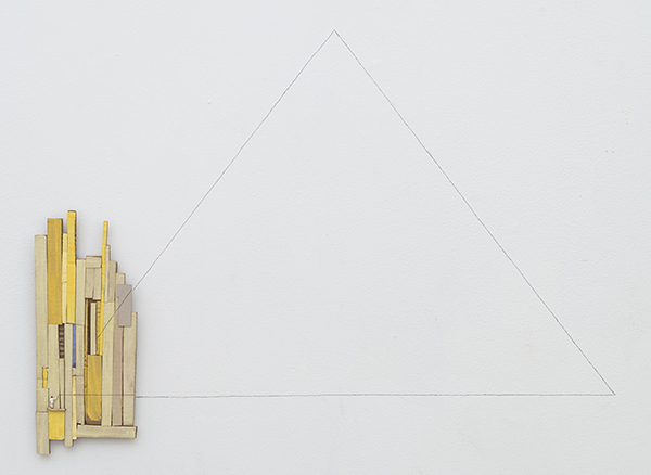 Triangle, 2017 Graphite, painted cardboard, and metal figurine on wall Dimensions variable